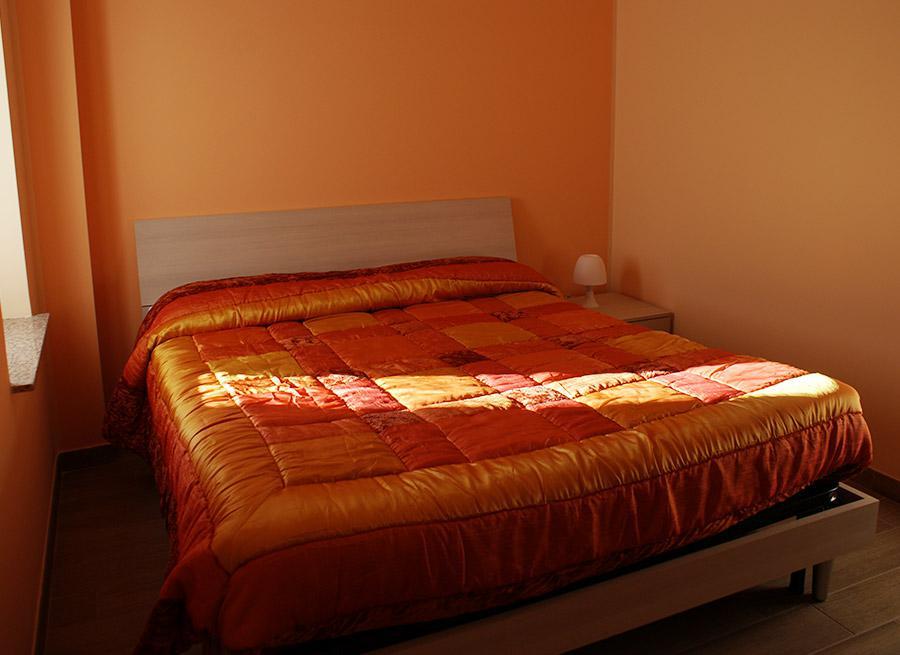 B&B L'Aquila del Parco - Il letto della camera arancione