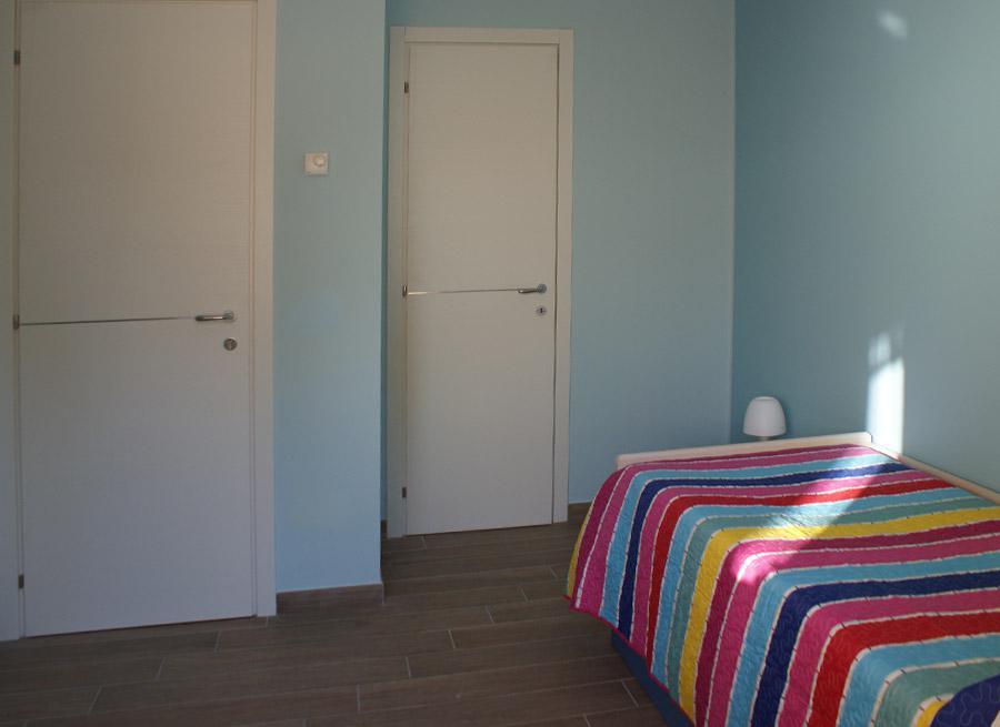 B&B L'Aquila del Parco - Il letto della camera azzurra